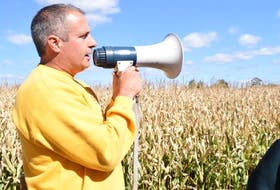 """<span class=""""Normal"""">RiverBreeze Farm and Cornmaze owner Jim Lorraine talks over the megaphone to customers taking a trailer ride out to the pumpkin u-pick. Joke after corny joke, Lorraine talked about his pumpkin patches, as well as the type of corn used in the annual corn maze.</span>"""