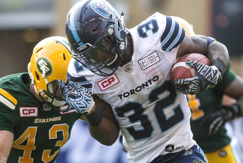 Toronto Argonauts running back James Wilder Jr. (right) rushes against the Edmonton Football Team in this file photo taken in Toronto on Sept. 16, 2017.