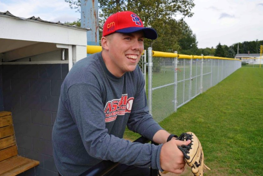<p>Catcher Sean Ferguson of the Sydney Sooners laughs while enduring a steady stream of friendly chirps from his teammates at team practice on Thursday. The 23-year-old from Howie Centre is back behind the plate after suffering a cardiac arrest on June 9.</p>