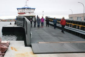 Passengers depart French ferry Suroît after docking in St. Pierre in this file photo.