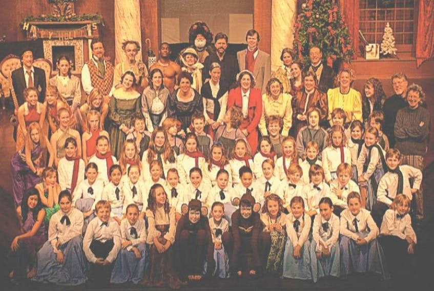 <p>This cast photo shows the last time travel story the Fezziwig Family Frolic produced. This year is a whole new version that transports Ebenezer Scrooge.</p>