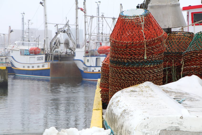 Crab pots piled on the wharf at the small boat basin on the south side of St. John's Harbour on an freezing rain and icy Monday. Many boats at Prosser's Rock boat basin are still not in the water. The fishery, like everything else, is being impacted by the COVID-19 pandemic.  Glen Whiffen/The Telegram