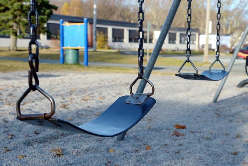 Swings hang empty in a St. John's schoolyard Monday afternoon. Keith Gosse/The Telegram