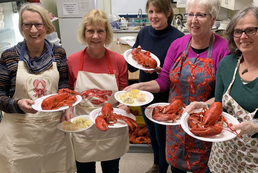 Steamed lobster is served at the Barrington Regional Curling Club's annual Lobster Spiel, one of the many events during the Nova Scotia Lobster Crawl in February.  A for Adventure photo