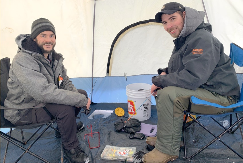 Friends and co-workers Matt Robinson, left, and Jordell Cameron enjoy getting outdoors and enjoying nature. The duo are avid fishermen, who this week went ice fishing on Shortts Lake, near Brookfield, for the first time.