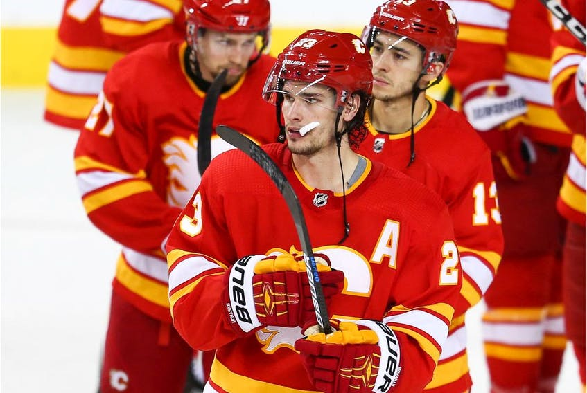 Calgary Flames Austin Czarnik, Sean Monahan and Johnny Gaudreau after losing game five of the Western Conference First Round during the 2019 NHL Stanley Cup Playoffs at the Scotiabank Saddledome in Calgary on Friday, April 19, 2019. Al Charest/Postmedia