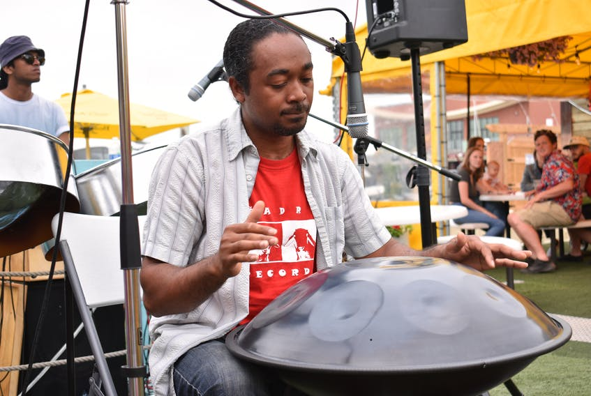 Steelpan musician Pepeto Pinto plays one of his drums and was the second act of the day at the Peake's Quay floating dock on Canada Day.