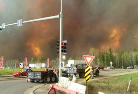 Photo taken by Karine Savoy as she and her family fled Fort McMurray Tuesday afternoon.