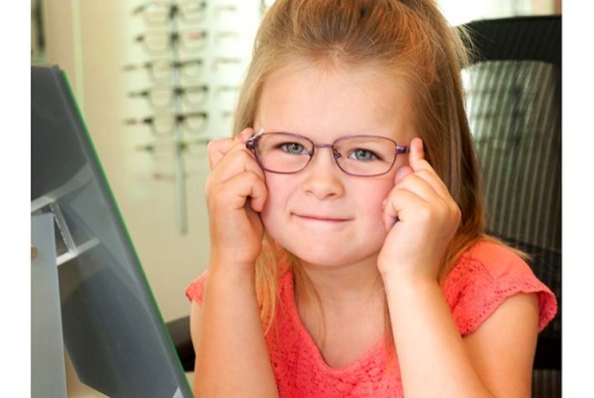<p>Five-year-old Brynlie Desroches tries on her new glasses. Kindergarten students in P.E.I. can get free eye exams and glasses through a program co-sponsored by government and private industry.</p>