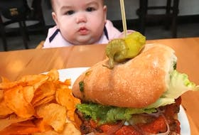 Ember, daughter of Ella and Josh Harris of Alberton, PEI, can't take her eyes off the gourmet burger served at her family's table. Ember's mother Ella is among many people who enjoy being creative with their burgers, whether cooking them at home or eating them at one of the many local restaurants across Atlantic Canada that serve such delicacies.