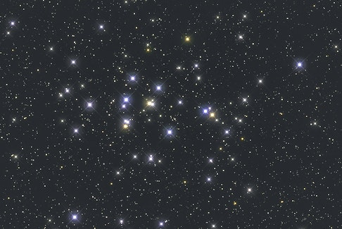 """Praesepe, the """"Beehive Cluster"""" (or M44 in the Messier Catalogue listing), is visible to the naked eye as a faint, nebulous patch of light. Try observing it with binoculars to get a full appreciation of the 1,000 or more blue-white stars in the cluster."""