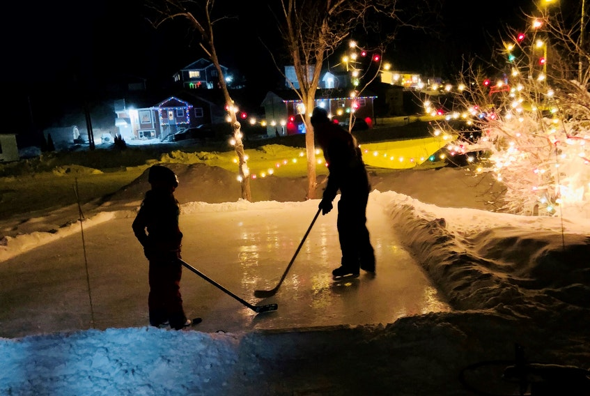 Aimee Maynard, who lives outside Corner Brook, N.L., has built a backyard rink for her daughter to help make memories.