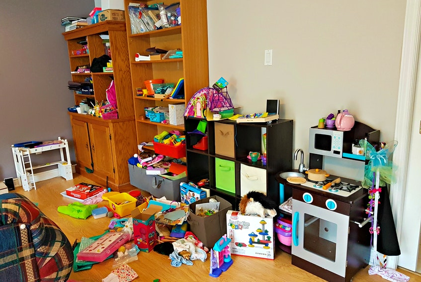 Pictured is a disorganized room before the cleanup by Wendy Stone, a professional organizer.