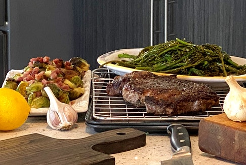 Mark DeWolf sears the perfect steak and seasons it with salt, pepper, butter, garlic, and thyme. CONTRIBUTED