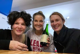 Emilie Chiasson toasts her new home with her friends Ally and Kate, who pitched in to finish off the final details of decorating and moving.