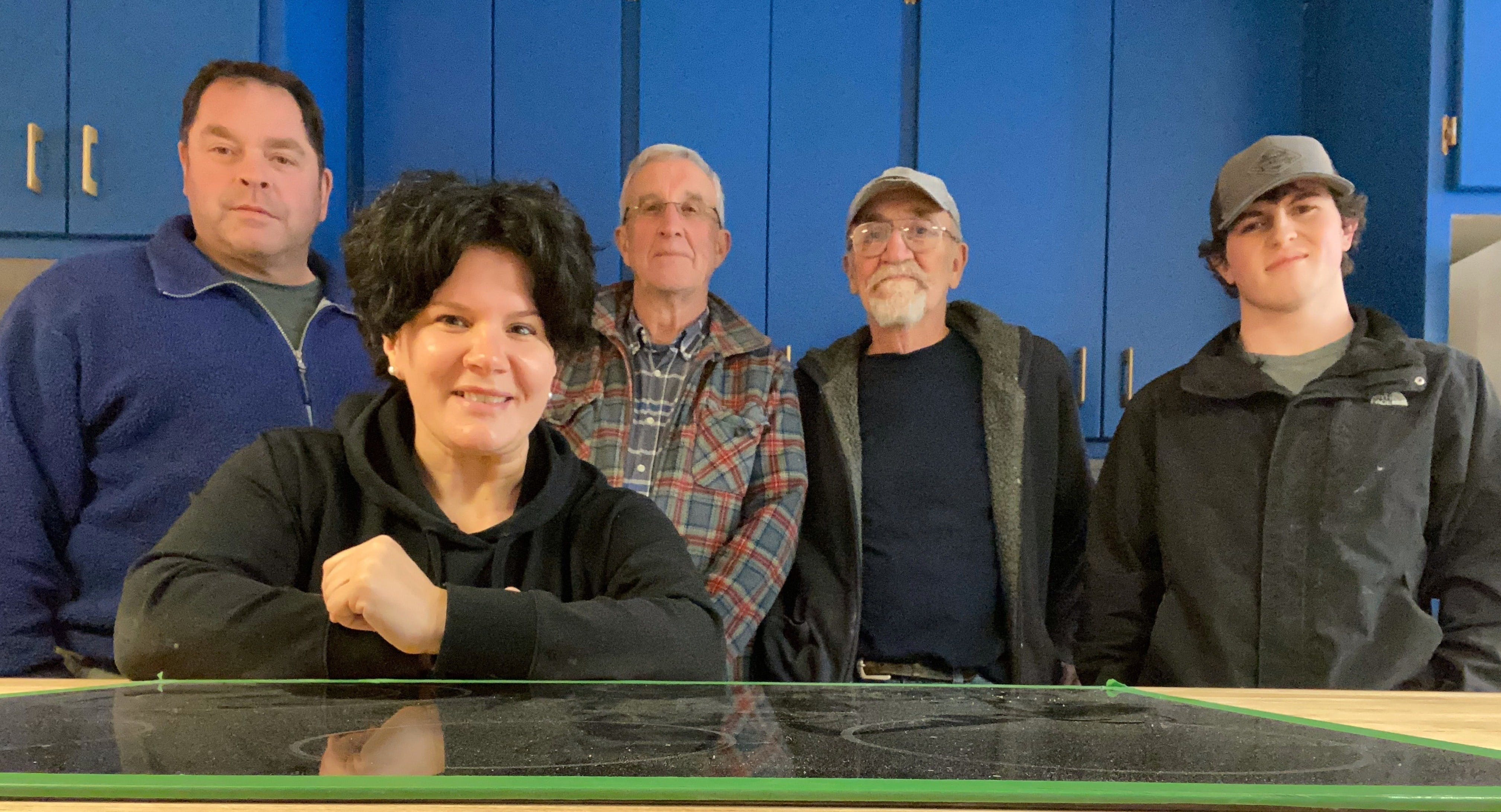 Columnist Emilie Chiasson is pictured with some of the people who have done renovation work on her house. CONTRIBUTED