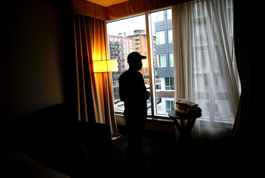 """""""Andy"""" is seen in a hotel room during an interview in Halifax Friday January 29, 2021. Andy recently escaped intimate partner violence and is planning to move into a new apartment in Halifax this month with the help of Barry House and Adsum for Women & Children.  TIM KROCHAK PHOTO"""