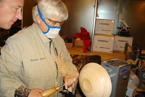 Dianne Looker turns the outside of a bowl using a lathe. Contributed photo/Dianne Looker