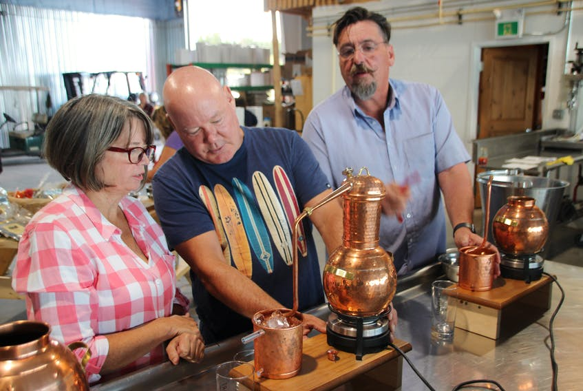 Wayne Johnson, centre, runs the GINstitute By the Sea experience at Steinhart Distillery in Arisaig, N.S. for owner Thomas Steinhart, right. Also pictured is participant Alison Stanton.