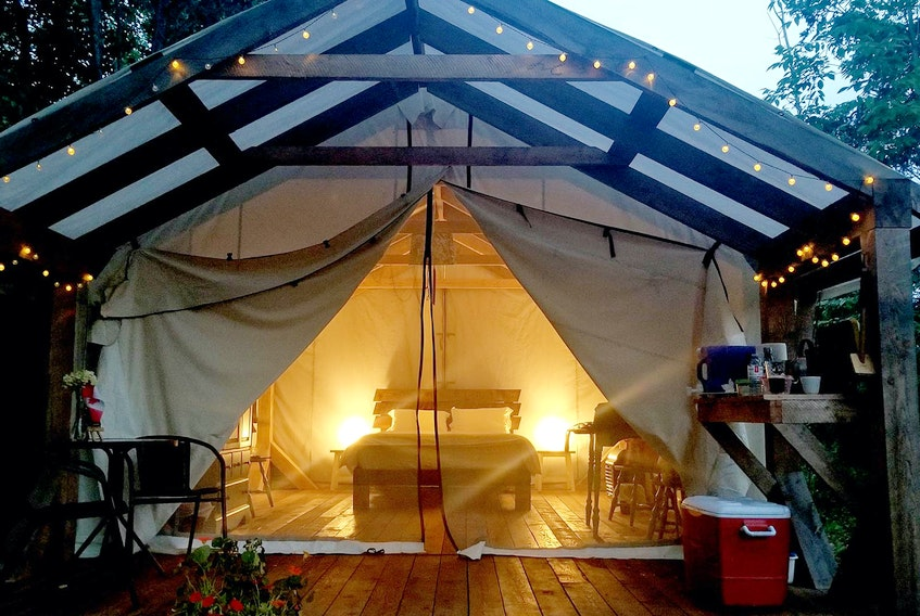 The solar glamping tents at Natura Wilderness are inviting after dark. CONTRIBUTED