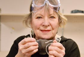 Jewelry maker Lynda Lou MacIntyre holds a bar of silver and the hand-made silver bracelet that can result from it. ELIZABETH PATTERSON/CAPE BRETON POST