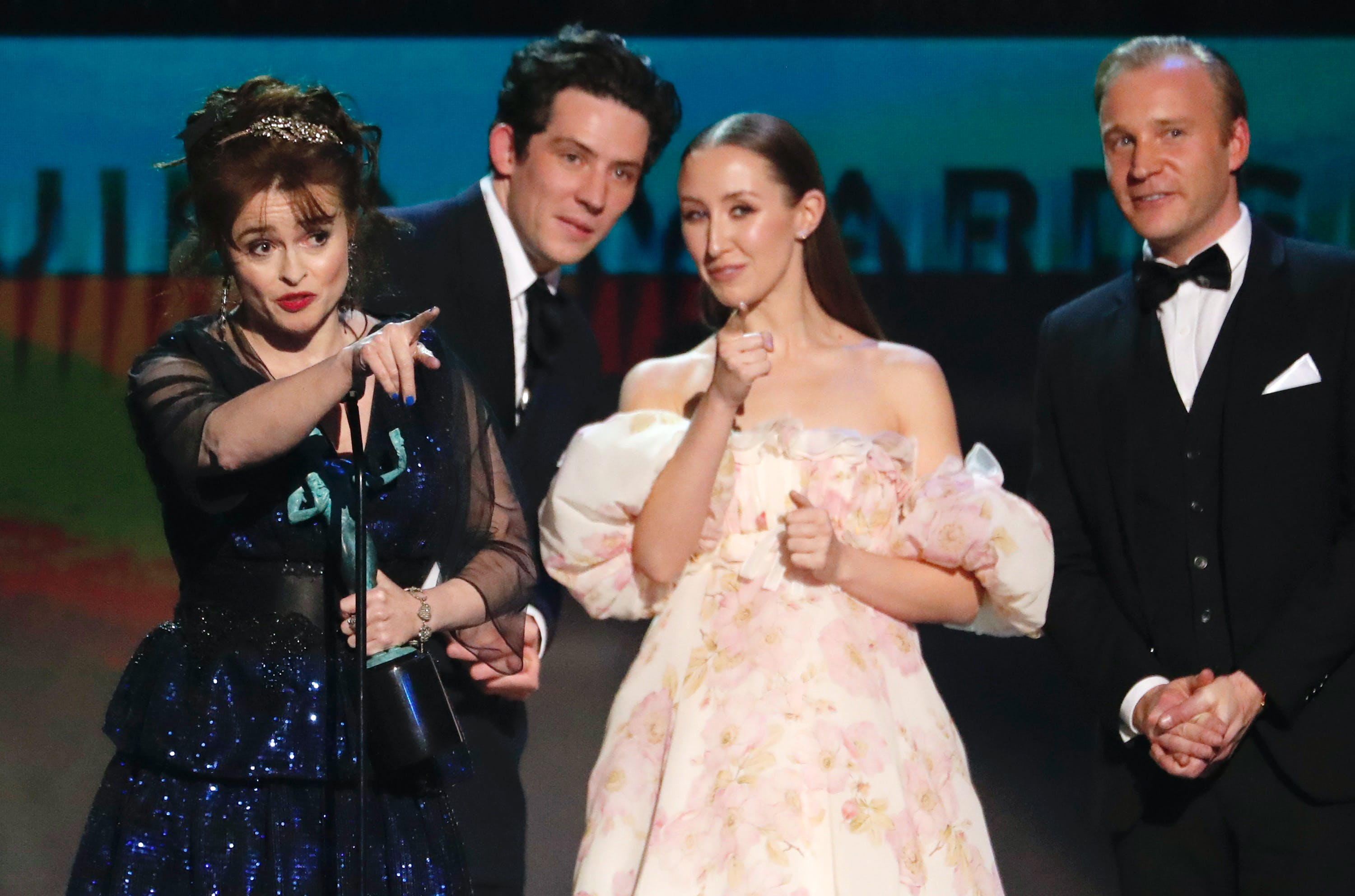 The Crown and Schitt's Creek led the contenders for the 2021 Golden Globes in TV. Here, cast members from The Crown, including Helena Bonham Carter, left, Josh O'Connor, Erin Doherty and Tobias Menzies accept the award for Outstanding Performance by an Ensemble in a Drama Series at the 26th Screen Actors Guild Awards in January 2020. - REUTERS/Mario Anzuoni
