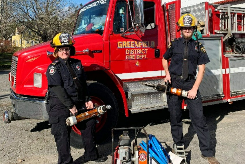 The Greenfield and District Fire Department will be hosting its annual Christmas tree lighting ceremony on Nov. 29. Shown here are Lt. Krista Crouse and Lt. Mathew Muise. - Contributed