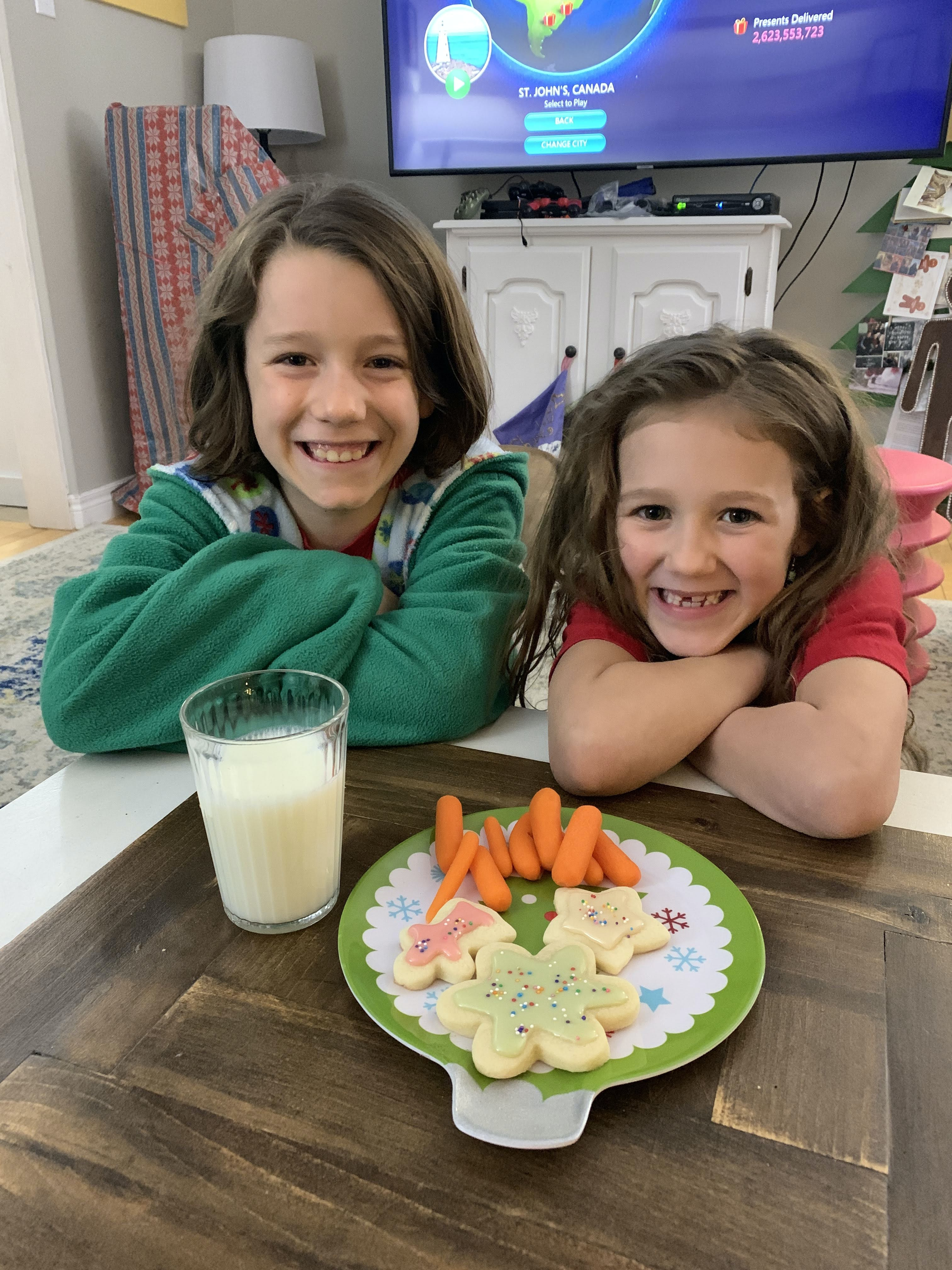 While Christmas won't be the same this year, there will still be pockets of joy. Above, Heather Laura Clarke's kids prepare to enjoy a holiday snack. Heather Laura Clarke Photo