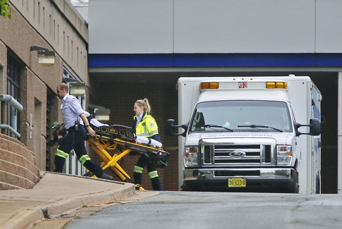In this file photo, an EHS ambulance crew arrives with an empty stretcher at the Halifax Infirmary. The provincial government recently announced a one-year pilot project to free up ambulances and paramedics by providing three passenger vans for non-emergency transportation of people between health-care facilities. Tim Krochak / SaltWire Network