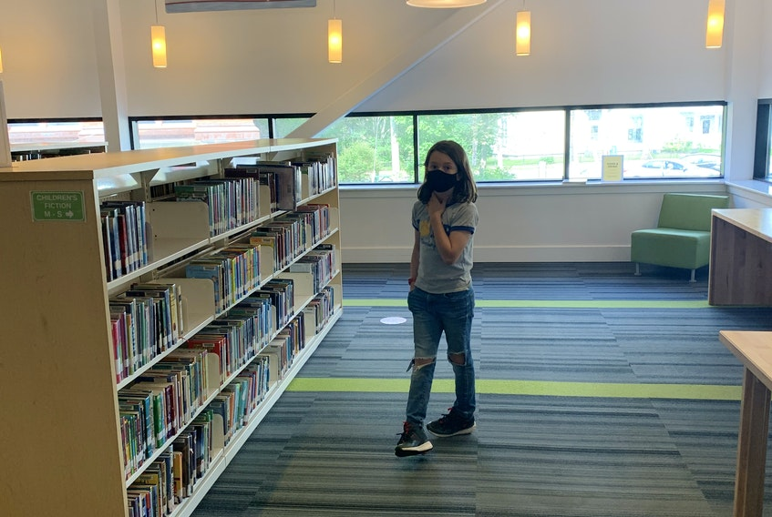 Heather's son, pictured here at the Colchester-East Hants Public Library, will be starting junior high in September. He won't get to use a locker, but he'll get to learn inside the building. HEATHER LAURA CLARKE PHOTO