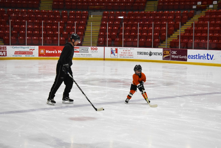 Ben Cumming having fun with daughter and hockey player Janelle, during a public skate at the Rath Eastlink Recreation Centre in the late fall.