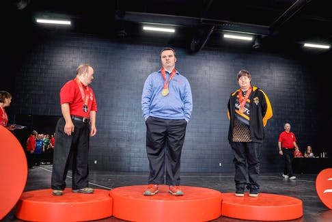 Geoff Burnes of Windsor recieves his medal on the podium at the Special Olympics national event. He won gold in the five-pin solo bowling event.