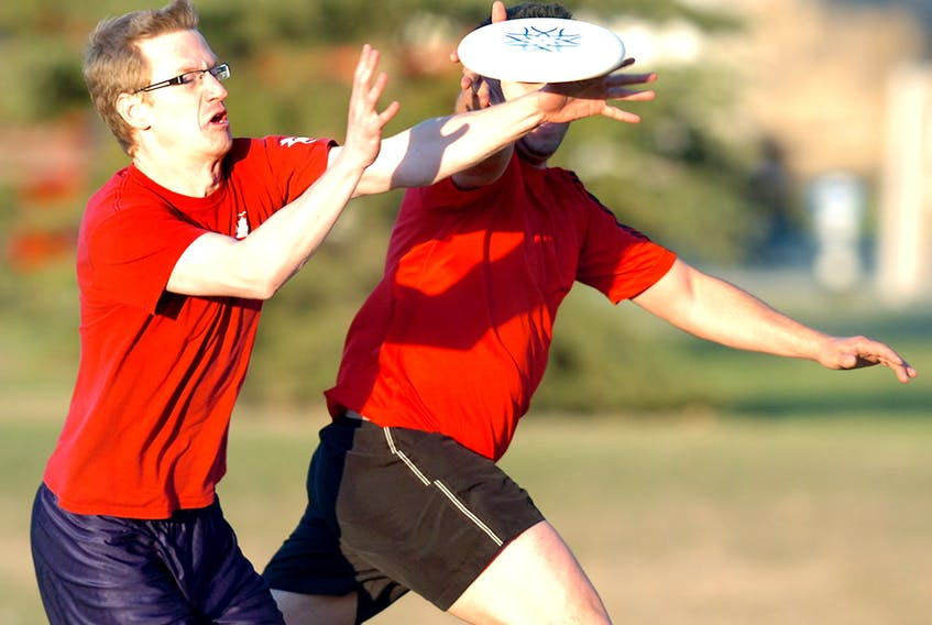 A spirited game of ultimate frisbee in Calgary's Renfrew Park.