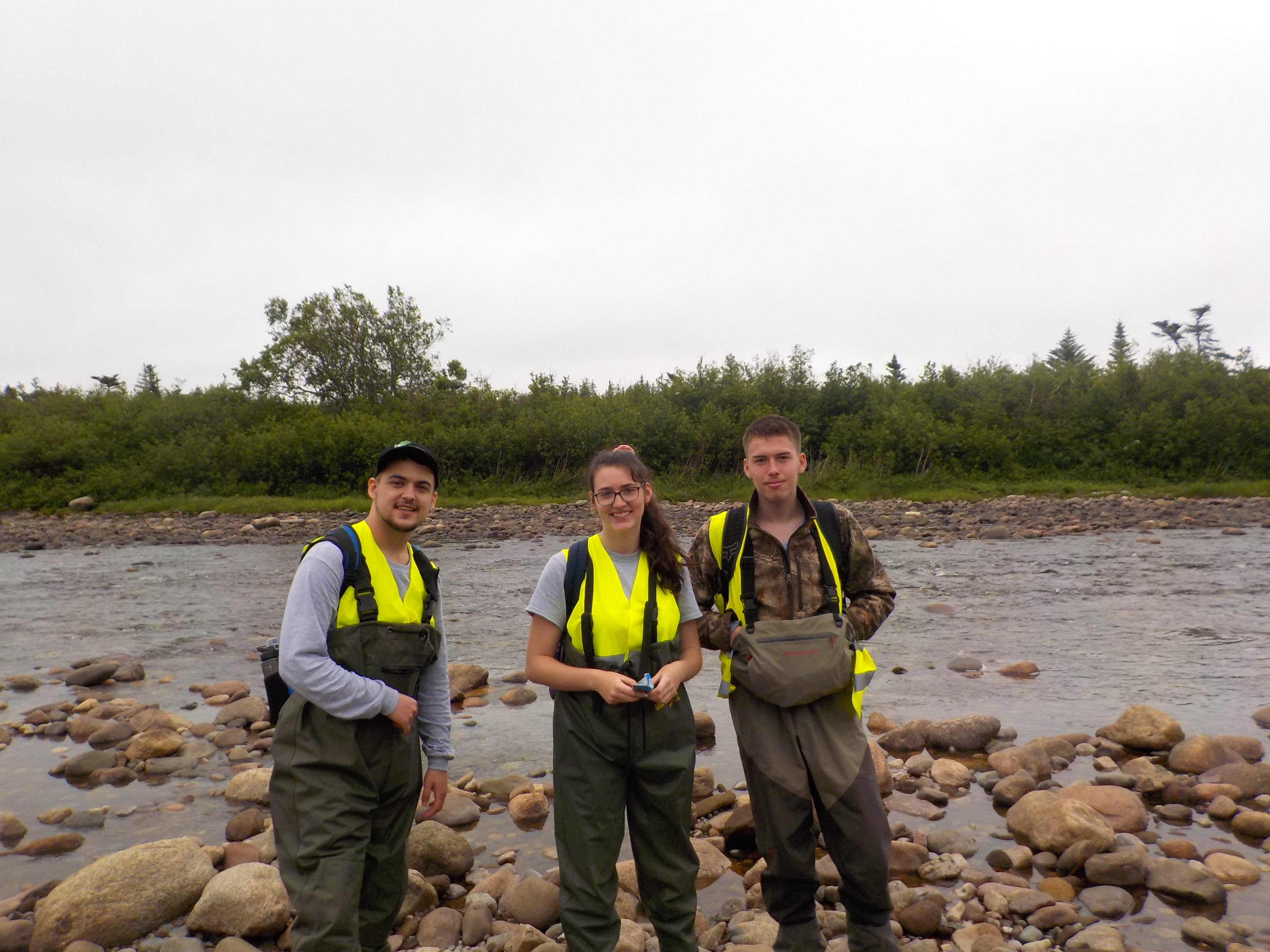 Members of the Bay St. George South Area Development Association's Green Team (from left) Jayson Griffin, Dawn Quilty and Jayden Harris are cleaning up debris from the tributaries of three rivers in the area.