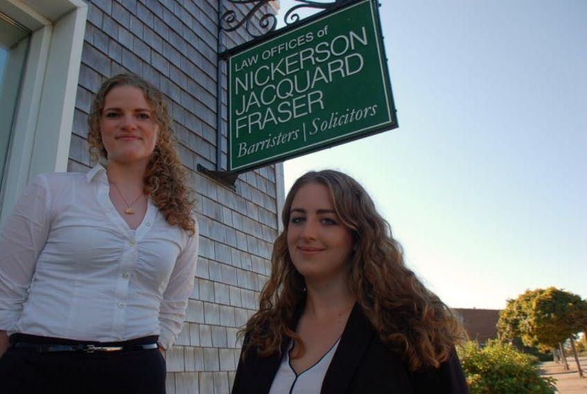 <p>Inga Fuessman and Julia Hubert are studying law in Germany. They recently completed a four-week internship with a local law firm.<br />CARLA ALLEN PHOTO</p>