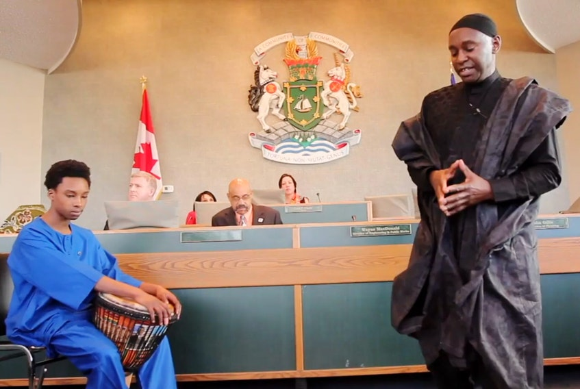 Guideon Lucas, right, an elder from Whitney Pier, takes part in an African Heritage Month proclamation ceremony at the Cape Breton Regional Municipality City Hall in this photo which was used in The Value Project documentary done by two youth workers at the Boys and Girls Club of Cape Breton. CONTRIBUTED