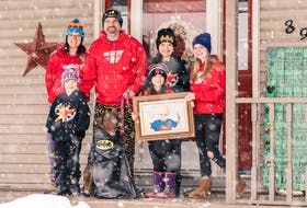 Nicole Forgeron-MacArthur and Mike Forgeron and their children Lauchlin, from left, and Emmy, Aubreigh and Ella, who are holding a photo of their late brother, Caleb. Harley Quinn the dog is also pictured. CONTRIBUTED