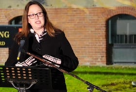 Trish Altass, shown in a file photo speaking at a rally outside the Coles Building, chaired an all-party special committee on poverty that has recommended the federal and provincial governments partner to implement a basic income guarantee on P.E.I.