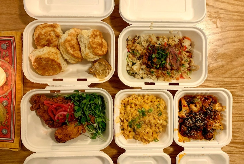 The weekly offerings for takeout at Seto change often, but their vegetable fried rice is a staple menu item, pictured here with roast duck on top.
