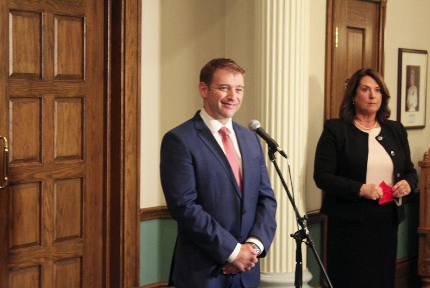 Premier Andrew Furey (left) and Deputy Premier Siobhan Coady speak with reporters on Monday.