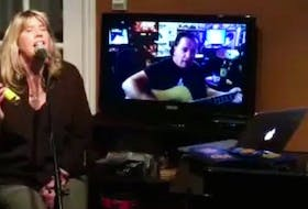 """Jenn Sheppard, centre, of New Waterford, performs during a recent """"garbage night"""" live streamed on Facebook with daughter Jordyn Crocker, left, and husband Stephen Muise. Last Thursday the event raised more than $14,000 for iPads for seniors in nursing homes. CONTRIBUTED"""