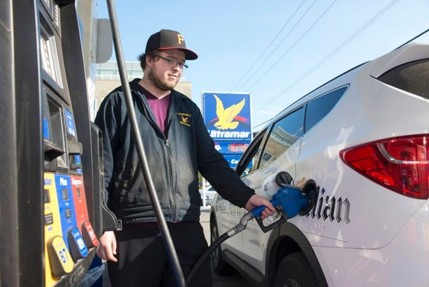 <p>Brandon Bouchard of Cudmore's Ultramar in Charlottetown, fuels up a Guardian vehicle Wednesday. The price of gas has dropped and now ranges from $107.5 cents per litre to $108.6 cents per litre. Diesel, furnace oil and stove oil prices also dropped five cents per litre.</p>
