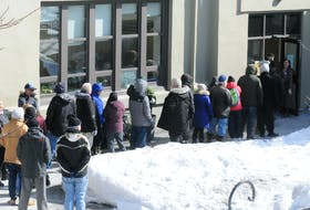 SHOT 16 MARCH 2020 JOE GIBBONS/The Telegram Guests of The Gathering Place line-up outside the facility over the lunch-hour period on Monday afternoon as they wait in line to go inside for their lunch meal. Due to the COVID-19 breakout, staff at The Gathering Place have had to take extra measures to help combat the safety of staff and guests.   -Photo by Joe Gibbons/The Telegram  PIC B: Photo of Joanne Thompson, executive director of The Gathering Place, speaking to Telegram reporter Barb Sweet on the COVID-19 affects to the centre there. -Photo by Joe Gibbons/The Telegram   PIC C: Photo of Audrey Hindy, a guest of The Gathering Place, seen here obtaining her lunch meal from kitchen volunteer Hilda Lambert as staff chef Walter Earle works away in the background. -Photo by Joe Gibbons/The Telegram