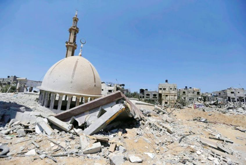 The dome of a mosque, destroyed by Israeli strikes during the war, is seen in Khuzaa, east of Khan Younis, in the southern Gaza Strip on Aug. 11, 2014
