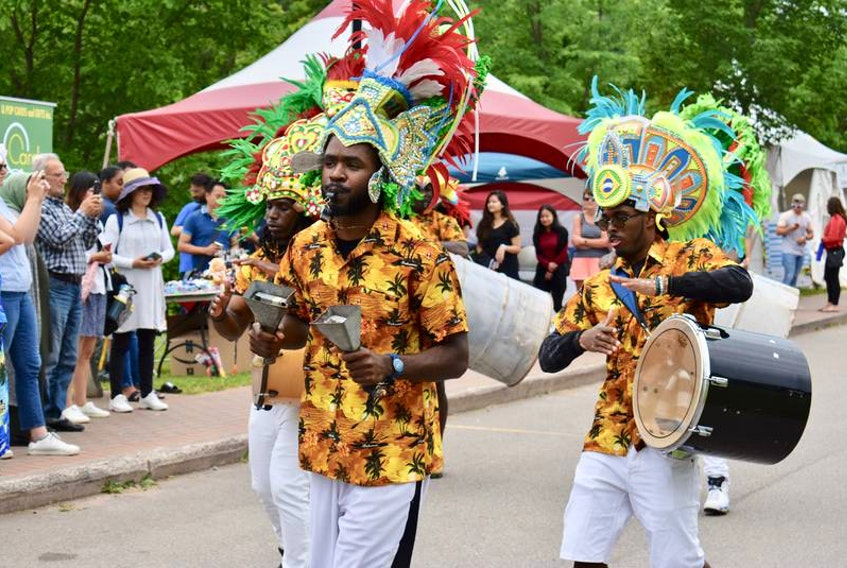 Members of the Rush Bohemian Jonkanoo band march along the Montague waterfront during the DiverseCity Multicultural Festival held in Three Rivers in July 2019. The event was part of the larger Montague Summer Days Festival.
