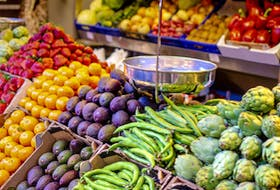 colorful fruits and vegetables in blocks with an scale on farmers market to sell fuits