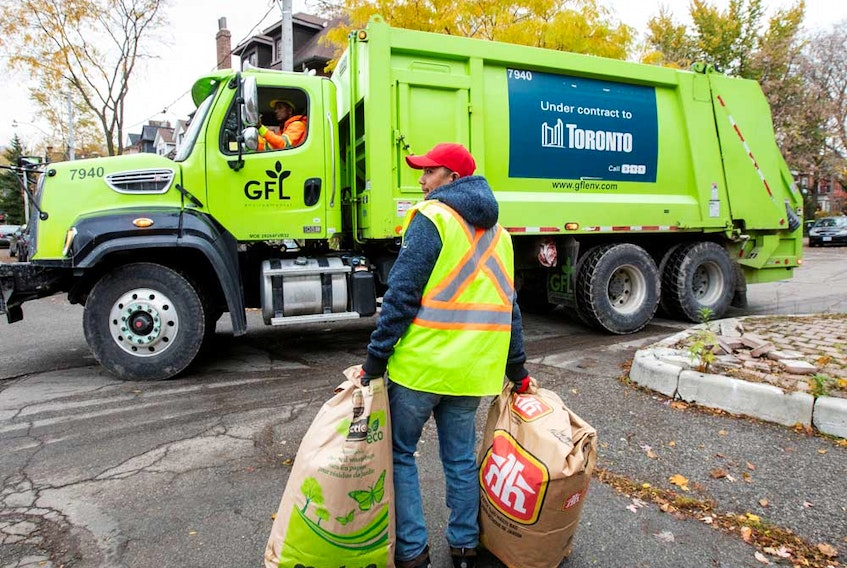 A truck from Canadian waste management company GFL Environmental Inc makes its rounds through a neighbourhood in Toronto.