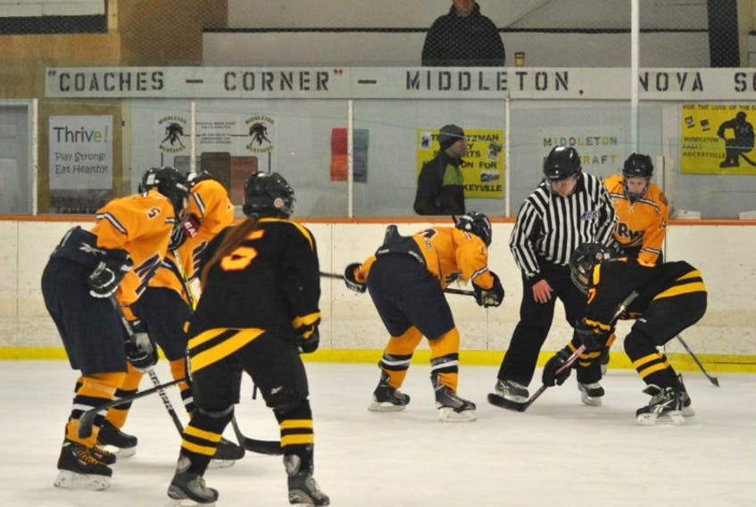 Middleton and Horton girls take a faceoff during the first game of Division 2 regionals that started at 9 a.m. in Middleton. MRHS defeated Horton 2-1 in the opener of the two-day tournament.