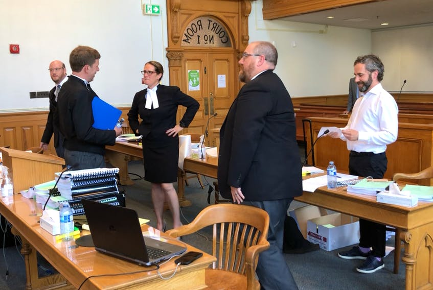 Lawyers on both sides of a constitutional challenge to the Government of Newfoundland and Labrador's COVID-19-related travel ban — Mark Sheppard, Justin Mellor and Don Anthony for the province, John Drover for complainant Kim Taylor and Rosellen Sullivan, for the Canadian Civil Liberties Association — are shown during a break in the hearing in Newfoundland and Labrador Supreme Court Tuesday.