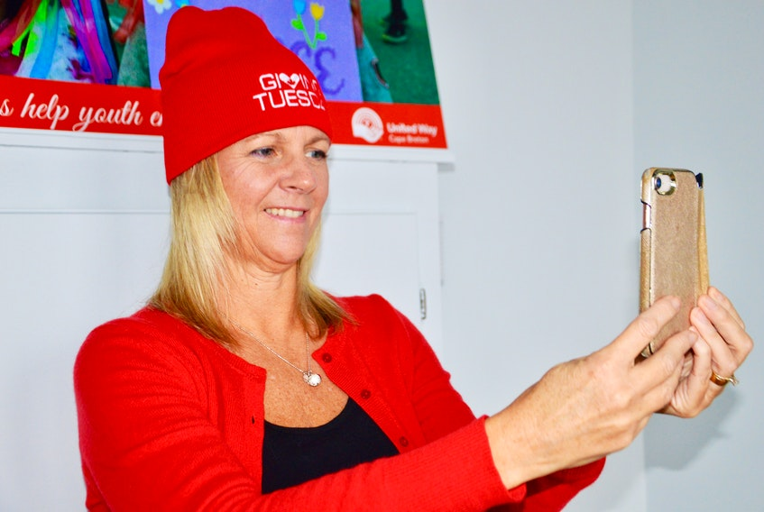 United Way of Cape Breton executive director Lynne McCarron takes an un-selfie — a photo of yourself if you're involved in Giving Tuesday or just helping others during this holiday season. ELIZABETH PATTERSON • CAPE BRETON POST